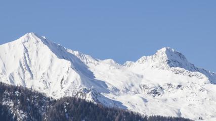 European alps full of snow in a blue sky