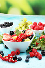 salad with fresh fruits and berries. healthy spring fruit salad