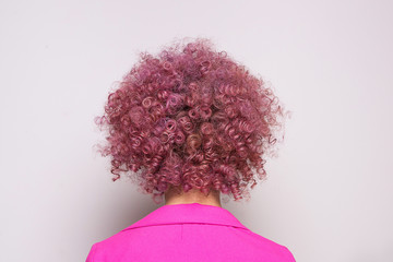 Lady with thick pink curly hair
