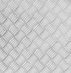 Metal floor plate with diamond pattern.