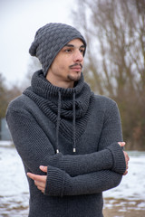 Close-Up Of Man In Warm Clothing Standing Against Sky