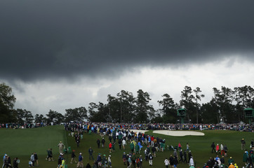 Stormy skies loom over the course during third round play of the 2018 Masters golf tournament in Augusta