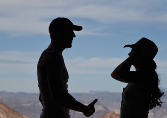 Silhouette of young couple looking at each other