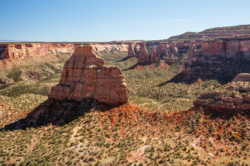 Hiker is sitting on the cliff in Colorado National monument, USA