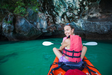 Women are kayaking in the sea caves at the Krabi shore, Thailand