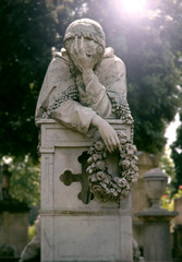 Statue of the grieving woman with a wreath of flowers in her hand