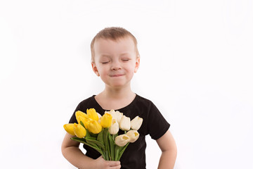 Young boy holding tulips isolated on white