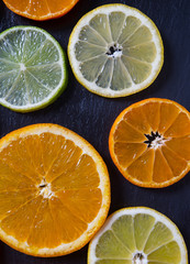 citrus fruit slices on dark surface