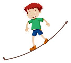 A Boy walking on a tightrope