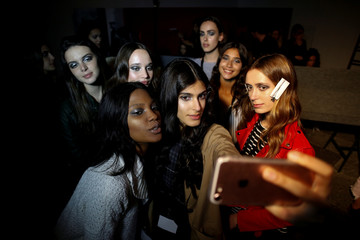 Models take pictures backstage before designer Fatima Lopes' Fall/Winter 2018/19 collection show in Lisbon