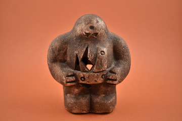 Prague golem stock images. Golem on a brown background. Prague golem statuette