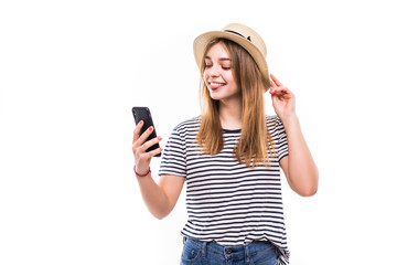 Beautiful young girl making video call with smartphone isolated on a white