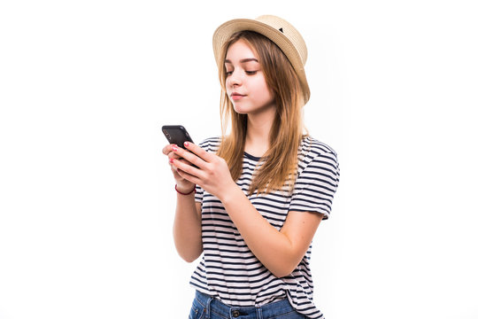 Young teen girl sending a sms on cell phone, isolated on white background