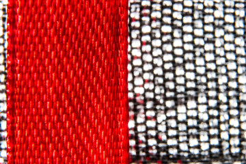 Macro background of red tape and metal fabric