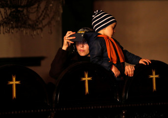A woman takes pictures with her mobile phone during the Orthodox Easter service at the Greek Orthodox Patriarchal Cathedral of St. George in Istanbul