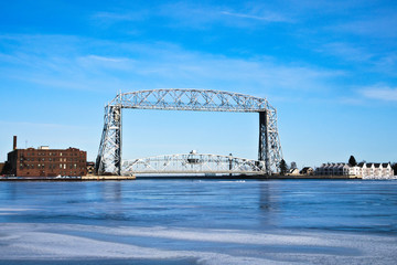 Duluth Minnesota aerial lift bridge with ice on sunny day