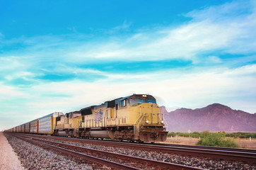Freight train crossing US Arizona desert.