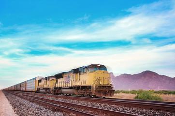 Freight train crossing US Arizona desert.