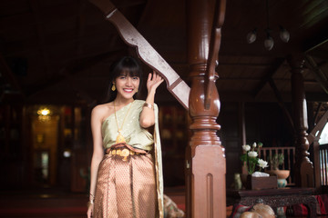 Nice and charming Thai girl with Thai ancient style dressing .