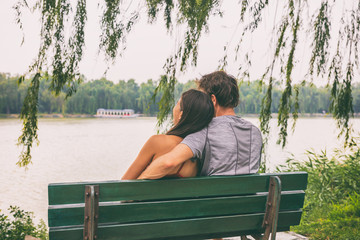 Aufkleber - Couple sitting on park bench honeymoon China travel. Young tourists in love looking at lake. Beijing summer palace, famous tourist attraction. Happy vacation concept.