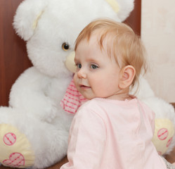 Portrait of a beautiful blonde child with toys