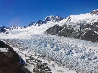 Fox glacier with blue sky backgorund, New Zealand westcoast south island natural landscape