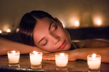 Relaxing woman sleeping in luxury spa resort in massaging hydrotherapy jets in whirlpool jacuzzi hot tub. Stress free meditation.