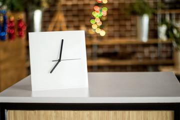 White clock on modern shelf. Mirror frame or interior room decoration.