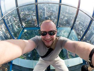 Selfie of man in Skybox of KL Tower in Kuala Lumpur