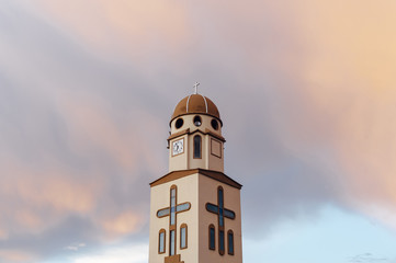 Salento church bell under colorful clouds  on a stormy afternoon, Quindio, Colombia