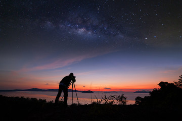 Photographer doing photography sunrise with milky way galaxy.