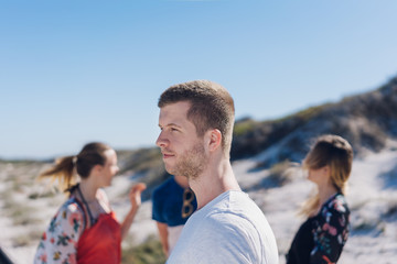 Group of young friends on a beach in Cape Town