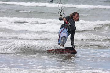kitesurfer riding toeside