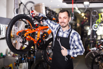 Cyclist is working on master bicycle assembly