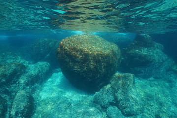 Underwater seascape large rock below water surface in the Mediterranean sea, Costa Brava, Cap de Creus, Catalonia, Spain