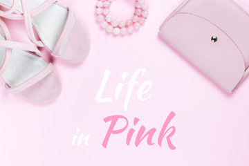 Life in pink card with woman fashion accessories in pink color on pastel background.