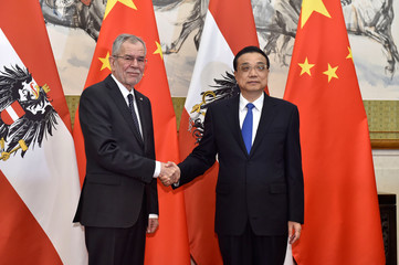 China's Premier Li Keqiang, shakes hands with Austria's President Alexander van der Bellen, before their meeting at the Diaoyutai State Guesthouse in Beijing