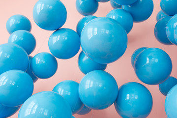 blue balloons, blue bubbles on pink background. Modern punchy pastel colors. Close up shot with...