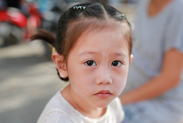 Close-up face of smiling cute asian child girl. Portrait beautiful girl.
