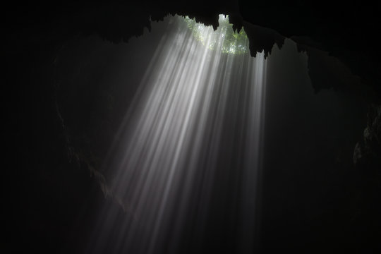 Illuminated cave at Goa Jomblang Tour near Yogyakarta, Indonesia