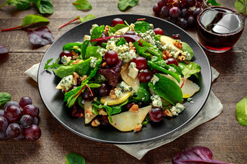 Fresh Pears, Blue Cheese salad with vegetable green mix, Walnuts, red grapes. healthy food