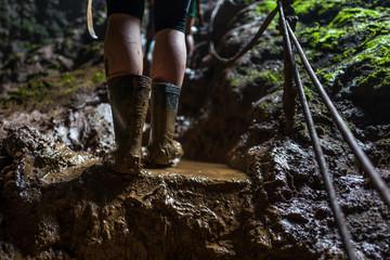 Muddy shoes at Goa Jomblang Tour near Yogyakarta, Indonesia
