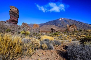 Rock formations (Roque Cinchado) and Mount Teide in Teide National Park. Tenerife, Canary Islands, Spain