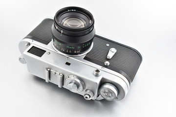 Old metal camera stock images. Vintage camera on a silver background. Old silver black camera