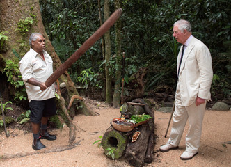 Britain's Prince Charles is accompanied by Roy Gibson, an elder of the Kuku Yalanji tribe, during a visit to the Daintree Rainforest