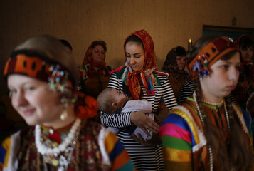 Members of the Nekrasov Cossack community attend a service on Easter Sunday at the Church of the Assumption in the settlement of Novokumsky