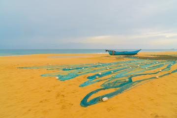 Wooden catamarans on the sandy beach of the Indian Ocean.