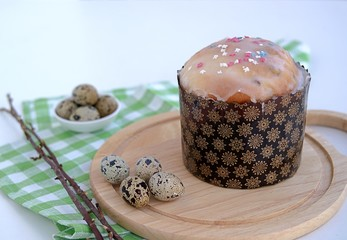 Easter cake with raisins, decorated with glaze and colored sugar powder