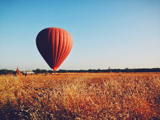Beautiful red air balloon. Sports and recreation travel theme. Nature background