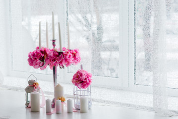 Vase of pink peony ,candle and sweets